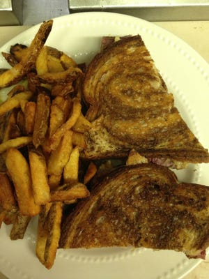The Nashotah Clubhouse's Reuben features a generous portion of the restaurant's beloved corned beef alongside hand cut french fries.
