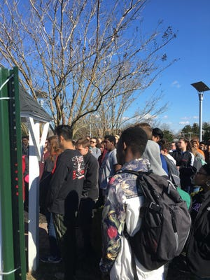 James M. Bennett students join in Wednesday's walkout.