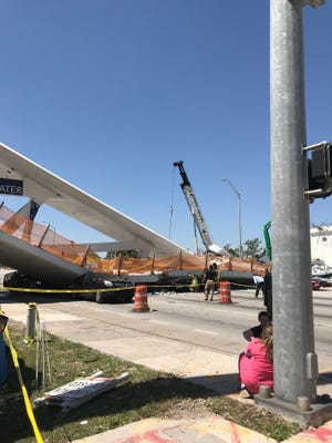 Isabella Carrasco posted this photo on Twitter showing a pedestrian bridge that collapsed at Florida International University in Miami on Thursday, March 15, 2018.