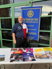 Paul Thomas, president of the Rotary Club of Abilene, shows support for the Family Night at The Grace Museum by educating attendees about the goal and mission of Rotary International.