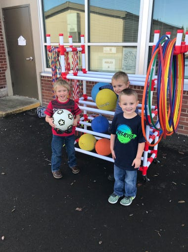 SES Students with playground toy cart donated by the