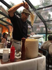 Executive chef and general manager Joe Volpe gets fresh cheese off a 60-pound wheel of pecorino right next to diners a few nights per week.