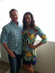 Rhiana Scholz and her husband Doug pose at their Ocean City condo.