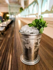 A mint julep is traditionally served in a pewter cup.