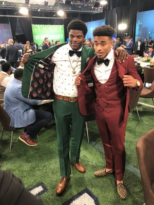 Jaire Alexander poses for a photo with Louisville teammate Lamar Jackson at the 2018 NFL draft before the two were selected in the first-round by the Packers and Ravens.