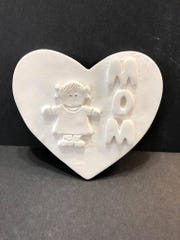 Moms love personalized gifts. Have your child make a special clay gift at Falcon Pottery & Art Studio.