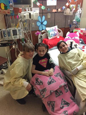 Taylor Swift met 8-year-old Isabella McCune on May 5, 2018 at the Arizona Burn Center. Isabella was badly burned in an accident and had made a video hoping Swift would come visit her in the hospital.