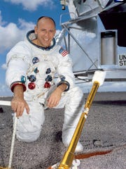 This undated photo shows Alan Bean posing in front