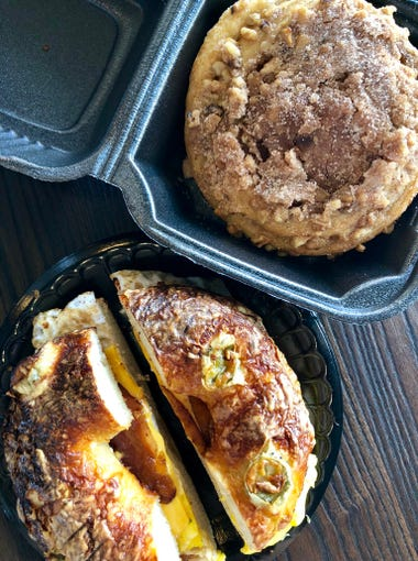 A jalapeno bagel with bacon, egg and cheese and a cinnamon