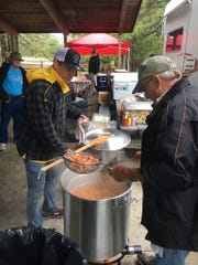 Volunteers serving boiled shrimp. Team Surfgimp and a new foundation honoring Milton surfer Jay Liesener held a fundraiser Sunday. Proceeds will help adaptive athletes.