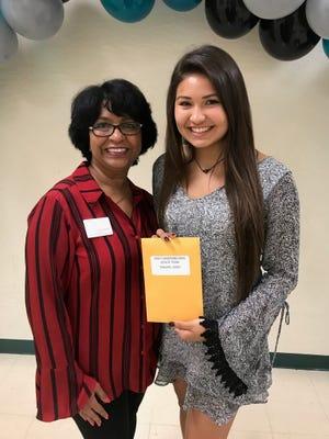 Realtor Arati Hammond, left, presents a $1,000 scholarship to Jensen Beach High School's Jazlyn Edwards.