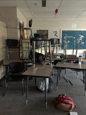 Students hide behind a barricade of desks and chairs in Noblesville High School on May 25. The harrowing wait that followed brought into sharp focus for some panicked parents the security concerns they'd brought up before.