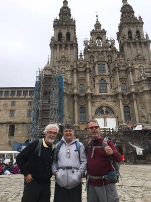 Jerry Osteryoung, Morgan and Gregg Patterson at the end of the 400 mile journey in front of the Cathedral In Santiago.