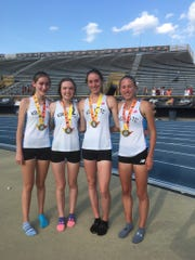 Ursuline's distance-medley relay team claimed first