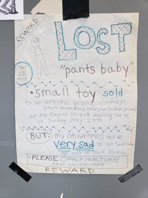 "An East Lansing mother of two daughters said she regrets selling a toy last month at a garage sale. She's posted signs in Lansing's Eastside Neighborhood in an attempt to try and get ""Pants Baby"" back."