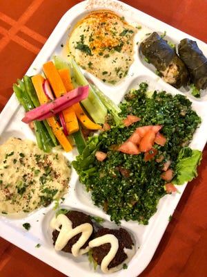 The Tour of Byblos Mezza, a platter of hummus, baba ghanouj, tabouli, falafel and grape leaves, from Phoenician Lebanese Bistro in North Naples.