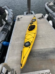 The yellow kayak of Eric Plett, 41, of Weehawken, New