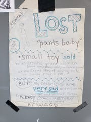 "One of the fliers that an East Lansing mother of three children posted at several Lansing businesses on the city's east side that sought the 4-inch doll known as ""Pants Baby."""