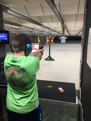 A boy in the Youth Firearms Academy in the Tactical Training Center.