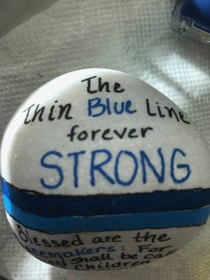 Susette  London Lewis painted a rock in honor of injured Fort Myers Police officer Adam Jobbers-Miller.