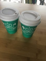 A hot chocolate and chocolate milk from new donut spot,