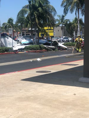 A small, twin-engine Cessna bound for John Wayne Airport in Orange County crashed into the parking lot of a Staples office supply store at about 12:30 pm Sunday, killing all five people aboard, Orange County fire officials said.