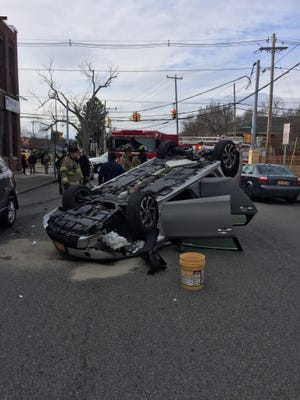 A car flipped after the driver hit the back left side of a parked car Sunday afternoon in the city of Newburgh. The driver was taken to the hospital with minor injuries.