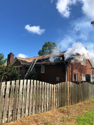 A Wilmington firefighter was injured battling a Saturday morning fire in Pine Valley.