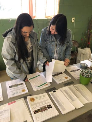 Logan Reather, left, Sebastian County Conservation District Education and Outreach coordinatior, and Bailey Lewis, CTA for Sebastian County Conservation, are seen here looking at incoming orders for the 2022 Tree Sale pre-order. The form for the pre-order can be found on the district's Facebook page @sebastiancountydistrict or on their website at www.sebastiancountyconservation.com.