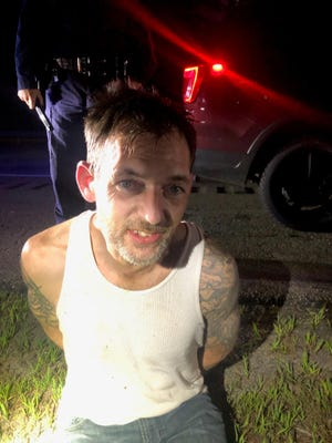Shaw Adams, 42, of Standish, Maine, was taken into custody without incident Friday, Aug. 7 after K9 Günther located him in the woods near a riverbank off Interstate 95 in York. Adams fled allegedly his vehicle after police stopped it using a spike mat.