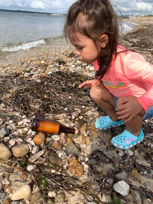 Lila Chin, 3, of Danvers, and her family came across a message in a bottle while looking for shells on Falmouth Heights Beach last weekend. The message said the bottle had been sent from the United Kingdom in 2009.