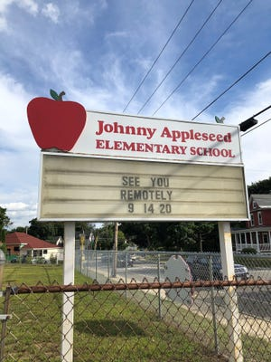 The sign outside Johnny Appleseed Elementary School announced Monday afternoon that classes -- for some students -- will resume remotely on Sept. 14.