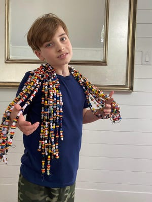 Parker Gerault now has more than 3,000 Beads of Courage, which sit in a jar in his living room. Parker was diagnosed three years ago with brain cancer.