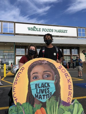 Whole Foods customers and community members supporting employees' campaign to wear Black Lives Matter attire on the job have started a Twitter account, @WFBLMcommunity. The account posted this photo leading up to a protest Saturday, July 18, at the Whole Foods in Fresh Pond, Cambridge.