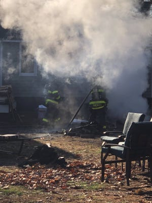 Concord firefighters extinguished an outdoor fire at 488 Fitchburg Turnpike on Nov. 10 before flames damaged the nearby home.