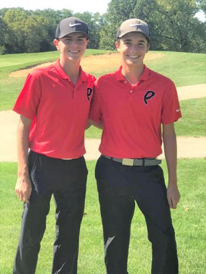 Pekin's Mason Minkel, left, and Carter Stevenson finished 1-2 in the individual standings in the Dragon Classic tournament.