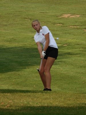 Pekin's Olivia Torrey chips during an Aug. 25 match against Dunlap at Kellogg Golf Course in Peoria.