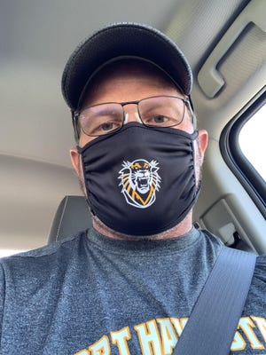 Fort Hays State football coach Chris Brown sports an FHSU Tiger mask.