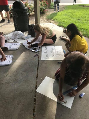 Four  girls ( Sage Koelling, Catalina Palacios, and Jordyn Hancock) are making signs and t-shirts to hand out during the McPherson Black Lives Matter March, which be on Saturday at 3 p.m.