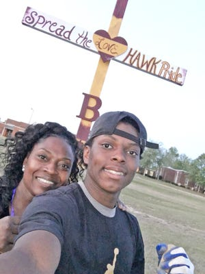 Zakia Cobb-Nix and her son, Zaveion Nix, placed this Hawk Pride cross in front of Blackville-Hilda High School.