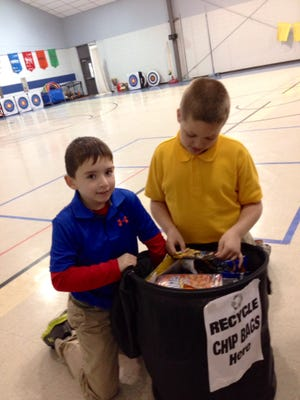 Hayden R. Lawrence Upper Elementary students Dalton Paul (left) and Tavin Reeder sort snack bags in a recycle bin in the school's gym. The school was recognized as a top collector of snack bag waste in a free national recycling program created by The Hain Celestial Group, Inc. and TerraCycle.