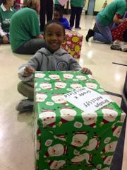 Julius Patrick Elementary student Bradyn Ratcliff beams with pride over his gift from Calvary Baptist Church members on Tuesday.