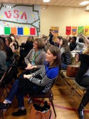 Rapides Parish elementary teachers practice using a hand gesture to represent capitalizing words as they read them from projector screen at Cherokee Elementary on Monday, Jan. 5. The exercise is part of a conference on Whole Brain Teaching, an education reform begun about 15 years ago.