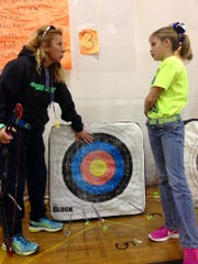 Phoenix Magnet Elementary physical education teacher Teresa Guillot answers a question from fourth-grader Skylar Strother about her score.