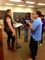 Northwestern State freshman Timothy Pemberton (right) asks singer/song-writer Wendy Colonna (left) about the business side of the music industry. Colonna returned to her alma mater, the Louisiana Scholars' College at NSU, to perform a concert Friday and met with students first.