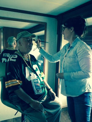James McGrath Sr. gets a little touch-up in the makeup chair during last June's filming of the NFL Ticket Exchange commercial at Lambeau Field.