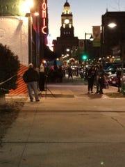 A camera crew sets up outside RoCA.