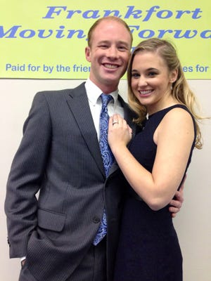 Frankfort Mayor Chris McBarnes, 26, smiles with fiancee Samantha Estes, 23, after announcing plans Monday to run for a second term.