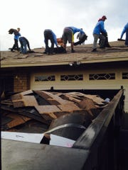 Employees with AllPhase Construction and Roofing work on the Phoenix home of a woman after an AllPhase employee reportedly stole $5,000 from the homeowner.