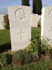 Some of the marked graves in Tyne Cot Cemetery in West Flanders, Belgium, include inscriptions from families. A Canadian soldier, 26, is remembered by his mother.